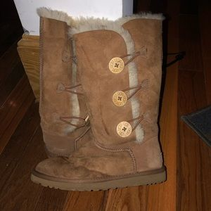 Tall brown uggs with buttons